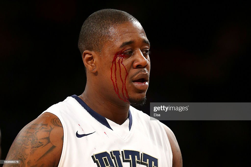 Dante Taylor #11 of the Pittsburgh Panthers has blood drip down his face after he drew contact in the second half during the quaterfinals of the Big East Men's Basketball Tournament at Madison Square Garden on March 14, 2013 in New York City.