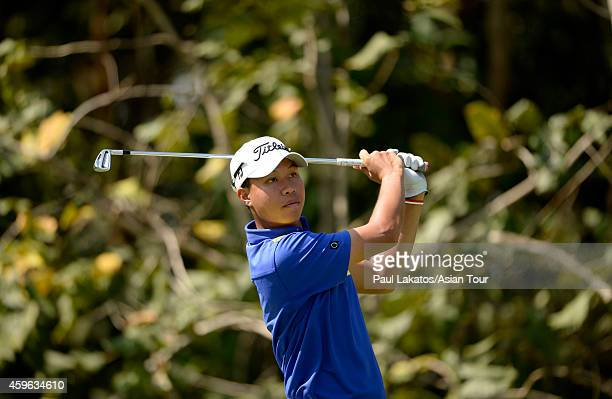 Danthai Boonma of Thailand plays a shot during round one of the King's Cup at Singha Park Khon Kaen Golf Club on November 27 2014 in Khon Kaen...