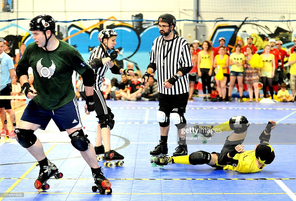 Danthrax of Chaos Engine and Triple of Panam Squad compete in the Mens European Roller Derby Championships at Futsal on July 21, 2013 in Birmingham, England.