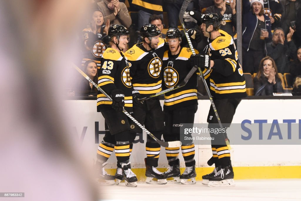 Danton Heinen #43, David Backes #42, Riley Nash #20 and Zdeno Chara #33 of the Boston Bruins celebrate a goal in the second period against the Arizona Coyotes at the TD Garden on December 7, 2017 in Boston, Massachusetts.