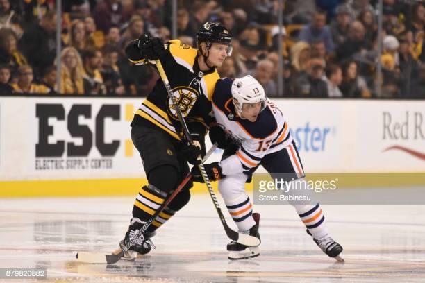 Danton Heinen of the Boston Bruins against Michael Cammalleri of the Edmonton Oilers at the TD Garden on November 26 2017 in Boston Massachusetts