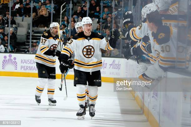 Danton Heinen of the Boston Bruins celebrates his third period goal with teammates during a NHL game against the San Jose Sharks at SAP Center on...