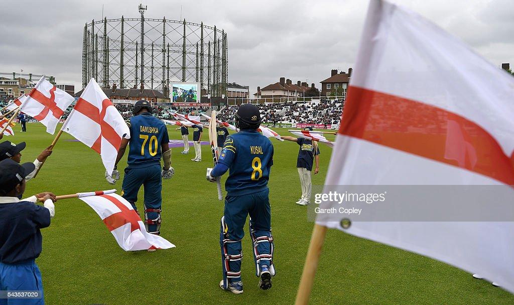 Danushka Gunathilaka and Kusal Perera of Sri Lanka walk out to bat ahead of the 4th ODI Royal London One Day International match between England and Sri Lanka at The Kia Oval on June 29, 2016 in London, England.