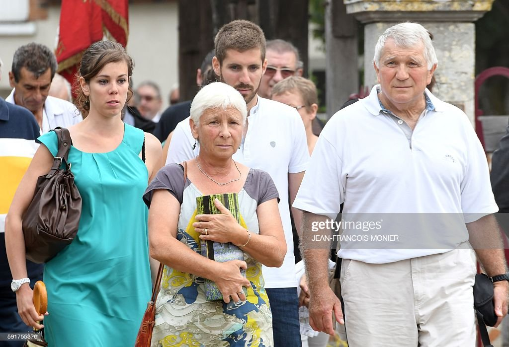 Dany and Michel Seguy carry the urn of their father late Georges Seguy former secretary general of the French trade union CGT during the funeral at...