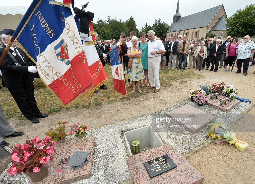 Dany and Michel Seguy pay their respects during the funeral of their father late Georges Seguy former secretary general of the French trade union CGT...