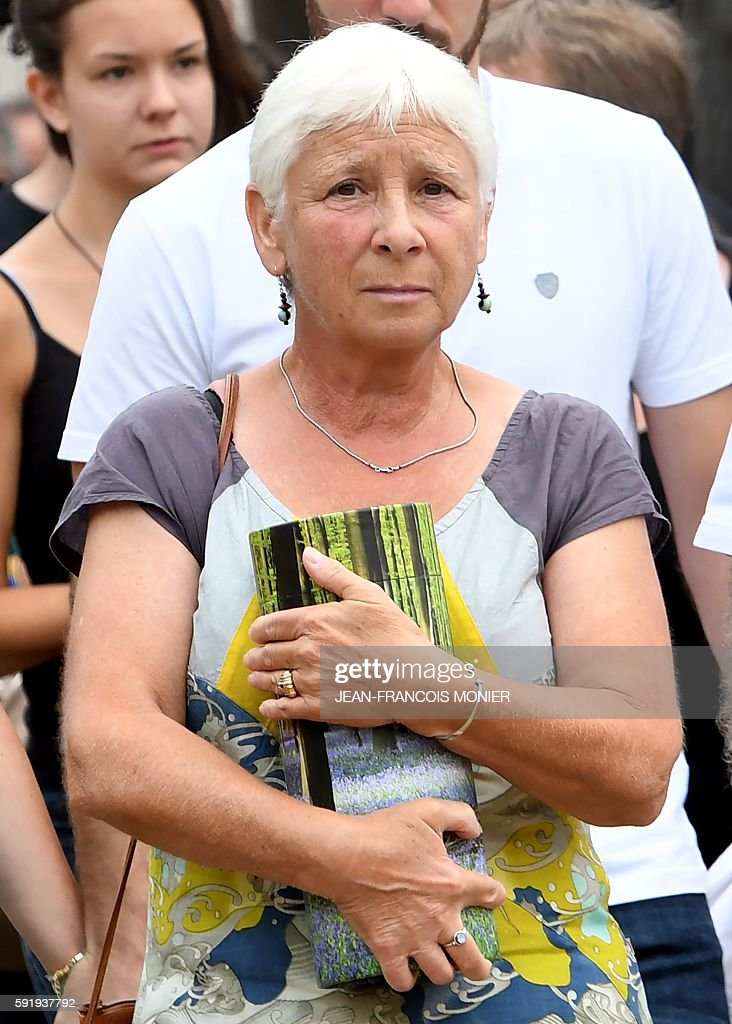 Dany carries the funeral urn of her father Georges Seguy then secretary general of the French trade union CGT during his funeral at the cemetary of...