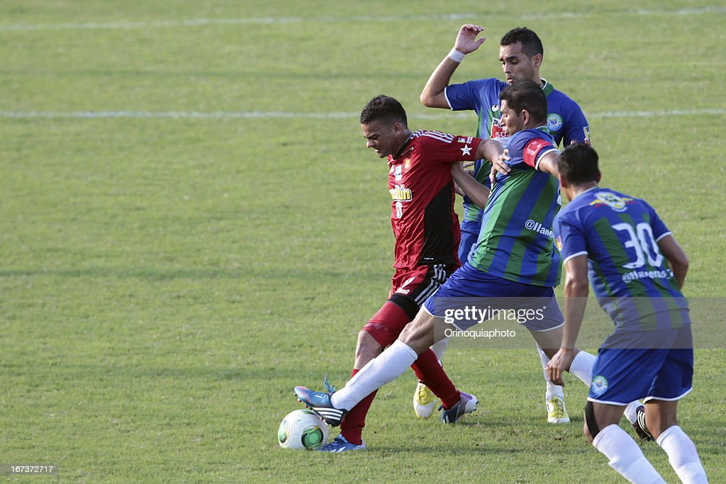 Dany Cure of Caracas FC fights for the ball during a match between Llaneros de Guanare and Caracas FC as part of the Clausura Tournament 2013 at the Estadio Olimpico Rafael Calles Pinto on April 24, 2013 in Guanare, Venezuela.