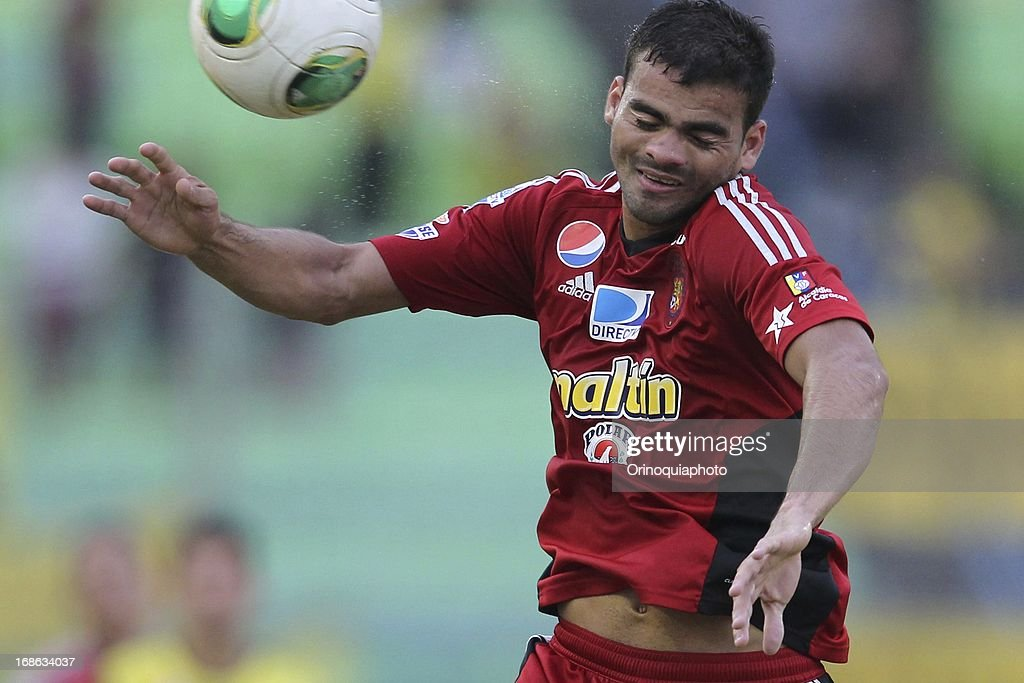 Dany Cure of Caracas FC jumps for the ball during a match between Caracas FC and Deportivo Tachira as part of the Torneo Clausura 2013 at Olympic stadium on May 12, 2013 in Caracas, Venezuela.