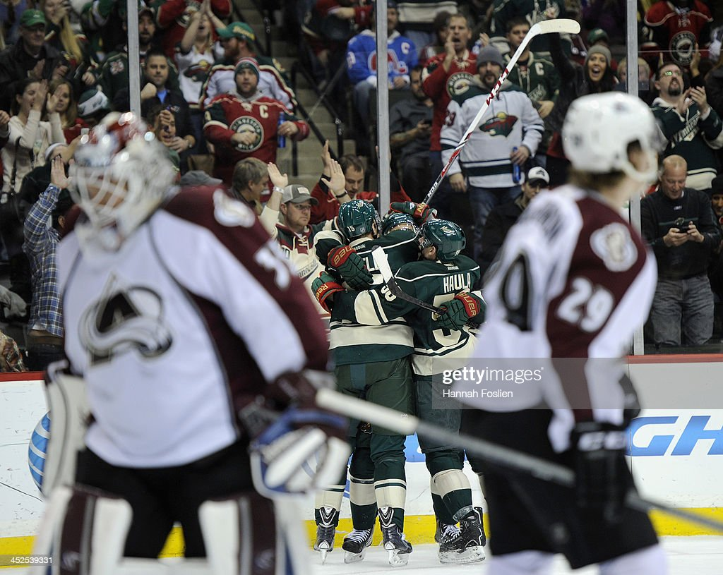 <a gi-track='captionPersonalityLinkClicked' href=/galleries/search?phrase=Dany+Heatley&family=editorial&specificpeople=202142 ng-click='$event.stopPropagation()'>Dany Heatley</a> #15, <a gi-track='captionPersonalityLinkClicked' href=/galleries/search?phrase=Nino+Niederreiter&family=editorial&specificpeople=6667732 ng-click='$event.stopPropagation()'>Nino Niederreiter</a> #22 and Erik Haula #56 of the Minnesota Wild celebrate a goal by Heatley as <a gi-track='captionPersonalityLinkClicked' href=/galleries/search?phrase=Jean-Sebastien+Giguere&family=editorial&specificpeople=202814 ng-click='$event.stopPropagation()'>Jean-Sebastien Giguere</a> #35 and <a gi-track='captionPersonalityLinkClicked' href=/galleries/search?phrase=Nathan+MacKinnon&family=editorial&specificpeople=8610127 ng-click='$event.stopPropagation()'>Nathan MacKinnon</a> #29 of the Colorado Avalanche look on during the second period of the game on November 29, 2013 at Xcel Energy Center in St Paul, Minnesota.