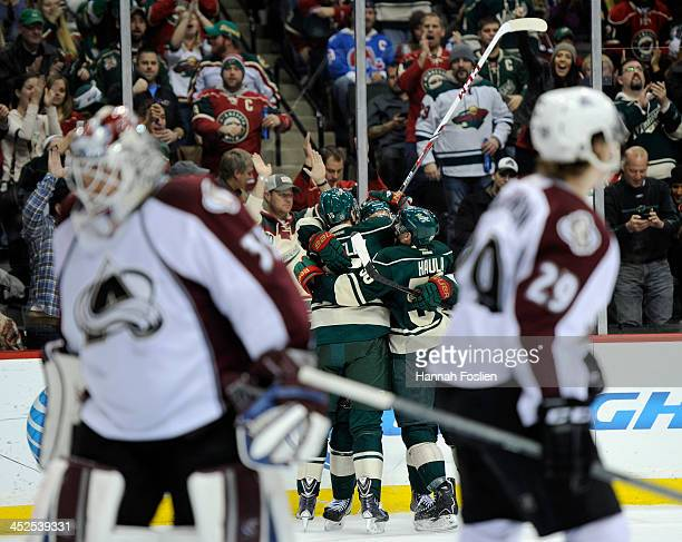 Dany Heatley Nino Niederreiter and Erik Haula of the Minnesota Wild celebrate a goal by Heatley as JeanSebastien Giguere and Nathan MacKinnon of the...