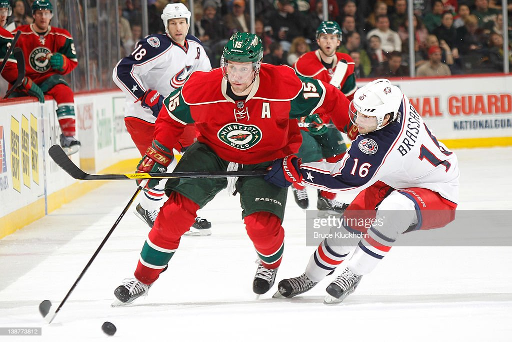 <a gi-track='captionPersonalityLinkClicked' href=/galleries/search?phrase=Dany+Heatley&family=editorial&specificpeople=202142 ng-click='$event.stopPropagation()'>Dany Heatley</a> #15 of the Minnesota Wild and <a gi-track='captionPersonalityLinkClicked' href=/galleries/search?phrase=Derick+Brassard&family=editorial&specificpeople=540468 ng-click='$event.stopPropagation()'>Derick Brassard</a> #16 of the Columbus Blue Jackets skate to the puck during the game at the Xcel Energy Center on February 11, 2012 in St. Paul, Minnesota.