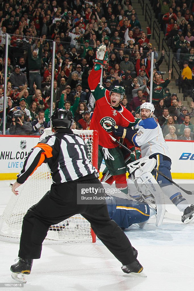 <a gi-track='captionPersonalityLinkClicked' href=/galleries/search?phrase=Dany+Heatley&family=editorial&specificpeople=202142 ng-click='$event.stopPropagation()'>Dany Heatley</a> #15 of the Minnesota Wild celebrates as Referee <a gi-track='captionPersonalityLinkClicked' href=/galleries/search?phrase=Kelly+Sutherland&family=editorial&specificpeople=804878 ng-click='$event.stopPropagation()'>Kelly Sutherland</a> signals his goal against the St. Louis Blues during the game on April 1, 2013 at the Xcel Energy Center in Saint Paul, Minnesota.