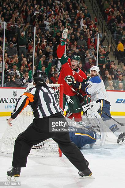 Dany Heatley of the Minnesota Wild celebrates as Referee Kelly Sutherland signals his goal against the St Louis Blues during the game on April 1 2013...