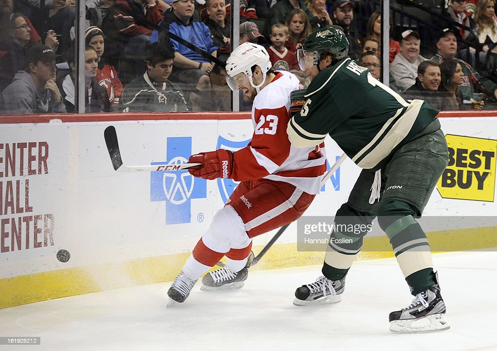 Dany Heatley #15 of the Minnesota Wild checks Brian Lashoff #23 of the Detroit Red Wings into the boards during the first period of the game on February 17, 2013 at Xcel Energy Center in St Paul, Minnesota.