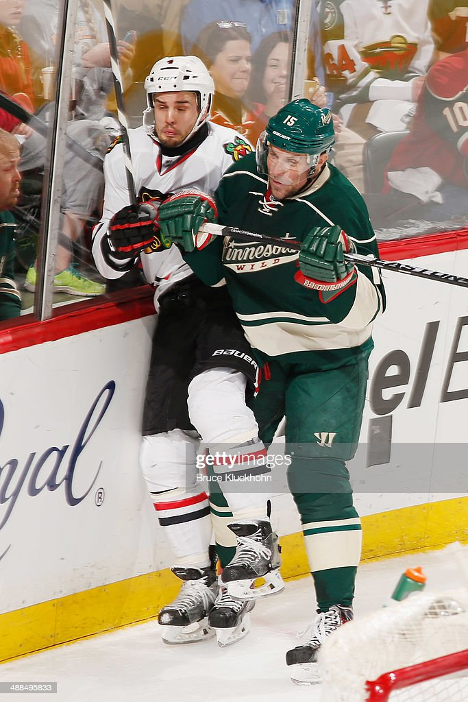 Dany Heatley #15 of the Minnesota Wild checks Niklas Hjalmarsson #4 of the Chicago Blackhawks during Game Three of the Second Round of the 2014 Stanley Cup Playoffs on May 6, 2014 at the Xcel Energy Center in St. Paul, Minnesota.