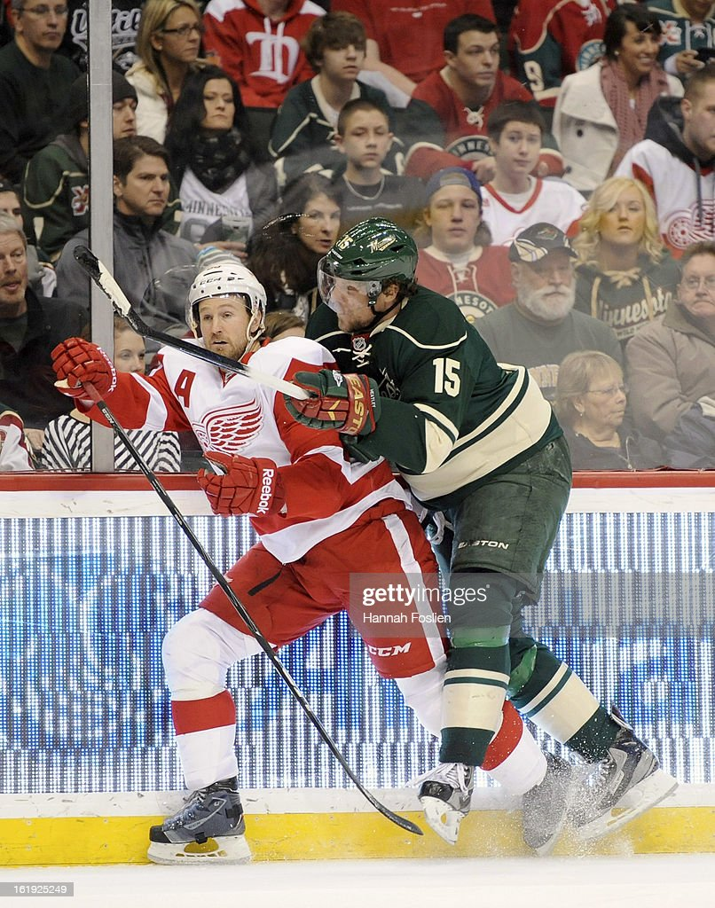 Dany Heatley #15 of the Minnesota Wild checks Niklas Kronwall #55 of the Detroit Red Wing into the boards during the first period of the game on February 17, 2013 at Xcel Energy Center in St Paul, Minnesota.