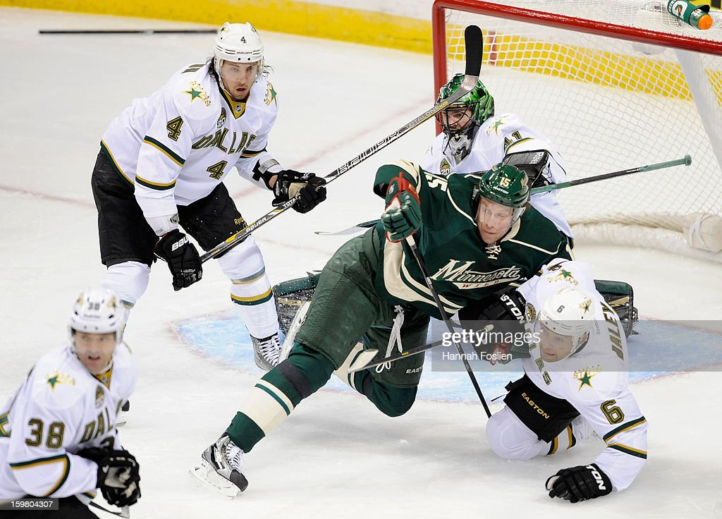 <a gi-track='captionPersonalityLinkClicked' href=/galleries/search?phrase=Dany+Heatley&family=editorial&specificpeople=202142 ng-click='$event.stopPropagation()'>Dany Heatley</a> #15 of the Minnesota Wild falls onto <a gi-track='captionPersonalityLinkClicked' href=/galleries/search?phrase=Trevor+Daley&family=editorial&specificpeople=213975 ng-click='$event.stopPropagation()'>Trevor Daley</a> #6 of the Dallas Stars during the first period of the game on January 20, 2013 at Xcel Energy Center in St Paul, Minnesota. The Wild defeated the Stars 1-0.
