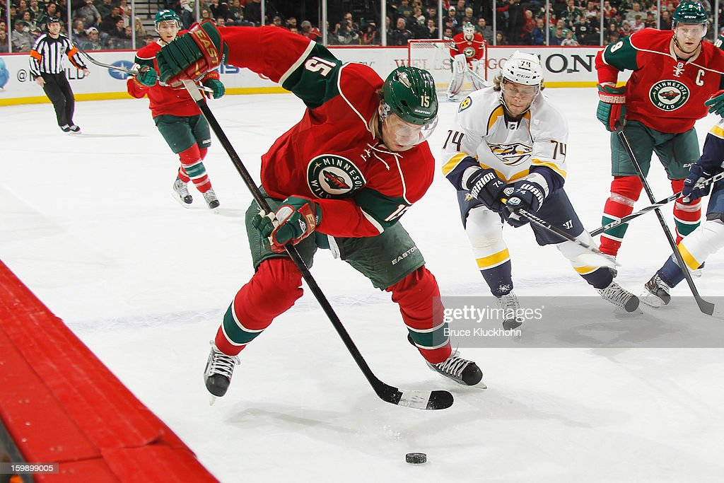 Dany Heatley #15 of the Minnesota Wild handles the puck with Sergei Kostitsyn #74 of the Nashville Predators defending during the game on January 22, 2013 at the Xcel Energy Center in Saint Paul, Minnesota.