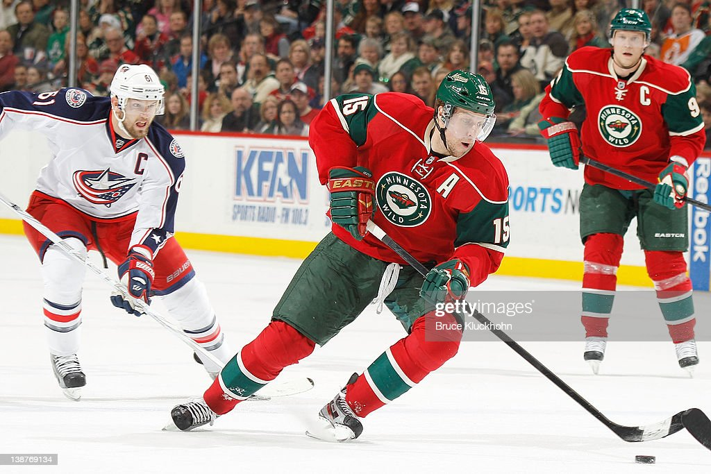 <a gi-track='captionPersonalityLinkClicked' href=/galleries/search?phrase=Dany+Heatley&family=editorial&specificpeople=202142 ng-click='$event.stopPropagation()'>Dany Heatley</a> #15 of the Minnesota Wild skates with the puck while <a gi-track='captionPersonalityLinkClicked' href=/galleries/search?phrase=Rick+Nash&family=editorial&specificpeople=202196 ng-click='$event.stopPropagation()'>Rick Nash</a> #61 of the Columbus Blue Jackets defends during the game at the Xcel Energy Center on February 11, 2012 in St. Paul, Minnesota.