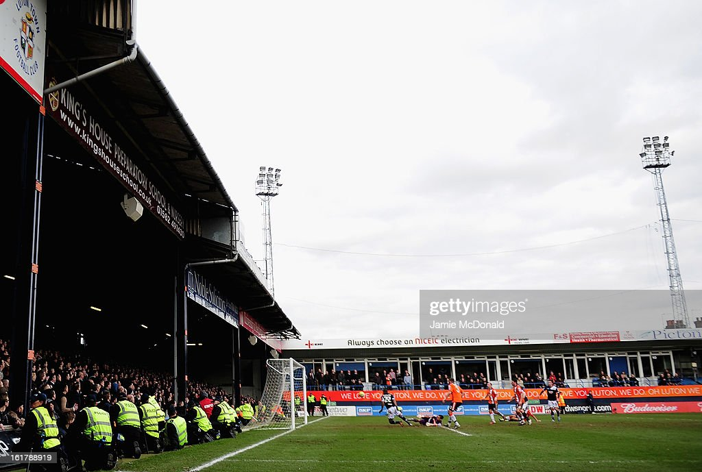 Dany N'Guessan of Millwall scores a goal as the police watch the crowd from the pitch during the FA Cup with Budweiser fifth round match between Luton Town and Millwall at Kenilworth Road on February 16, 2013 in Luton, England.