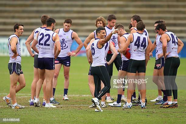 Danyle Pearce gives the thumbs up as players group up in the centre square during a Fremantle Dockers AFL training session at Fremantle Oval on...