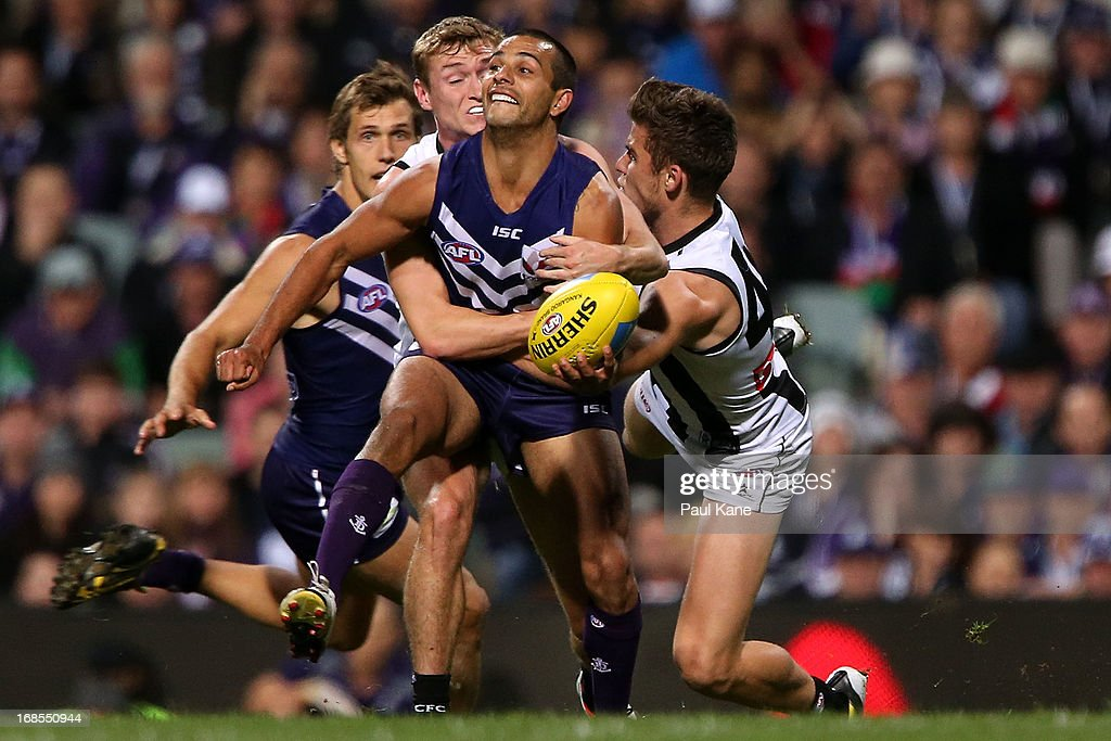 <a gi-track='captionPersonalityLinkClicked' href=/galleries/search?phrase=Danyle+Pearce&family=editorial&specificpeople=562986 ng-click='$event.stopPropagation()'>Danyle Pearce</a> of the Dockers gets tackled by Caolan Mooney and Paul Seedsman of the Magpies during the round seven AFL match between the Fremantle Dockers and the Collingwood Magpies at Patersons Stadium on May 11, 2013 in Perth, Australia.
