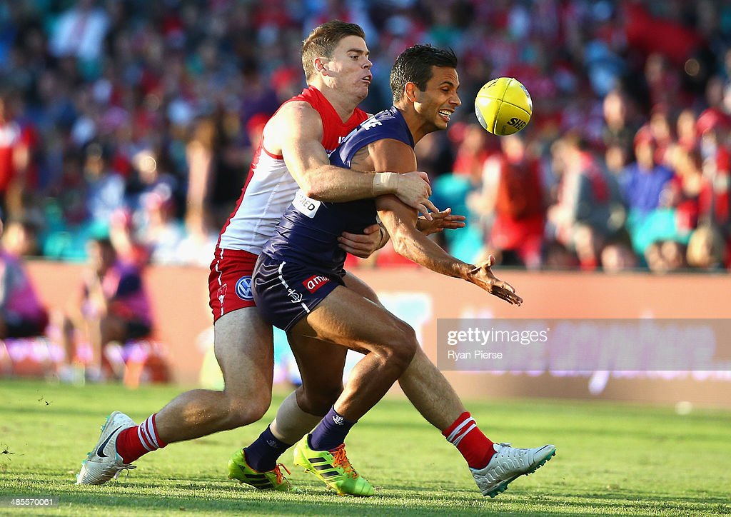 Danyle Pearce of the Dockers is tackled by Craig Bird of the Swans during the round five AFL match between the Sydney Swans and the Fremantle Dockers at Sydney Cricket Ground on April 19, 2014 in Sydney, Australia.