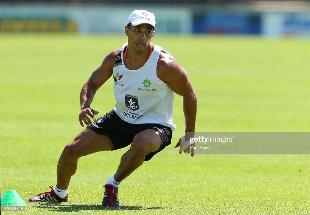 <a gi-track='captionPersonalityLinkClicked' href=/galleries/search?phrase=Danyle+Pearce&family=editorial&specificpeople=562986 ng-click='$event.stopPropagation()'>Danyle Pearce</a> runs thru an agility drill during a Fremantle Dockers AFL pre-season training session at Fremantle Oval on November 26, 2012 in Fremantle, Australia.