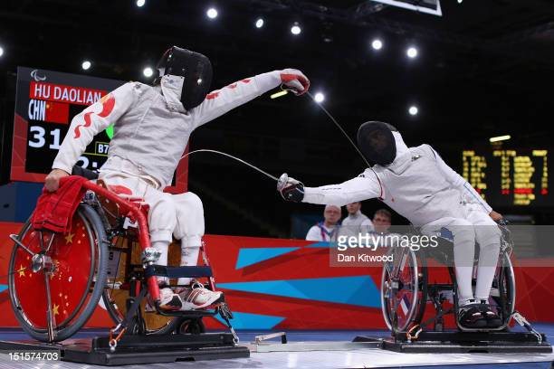 Daoliang Hu of China competes against Alim Latrech of France during the Men's Team Catagory Open Wheelchair Fencing Final on day 10 of the London...