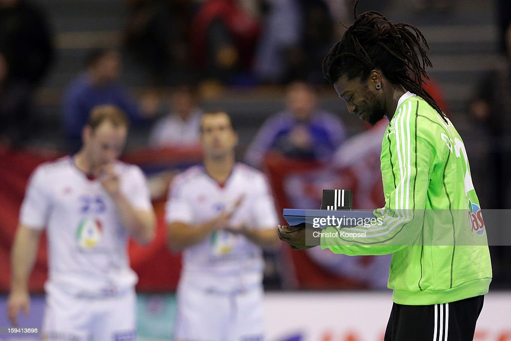 Daouda Karaboue of France celebrates after the premilary group A match between Montenegro and France at Palacio de Deportes de Granollers on January 13, 2013 in Granollers, Spain. The match between Montenegro and France ended 20-32.