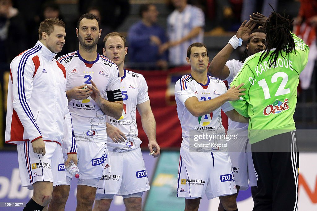 Daouda Karaboue of France (R) celebrates with his tean after the premilary group A match between Montenegro and France at Palacio de Deportes de Granollers on January 13, 2013 in Granollers, Spain.
