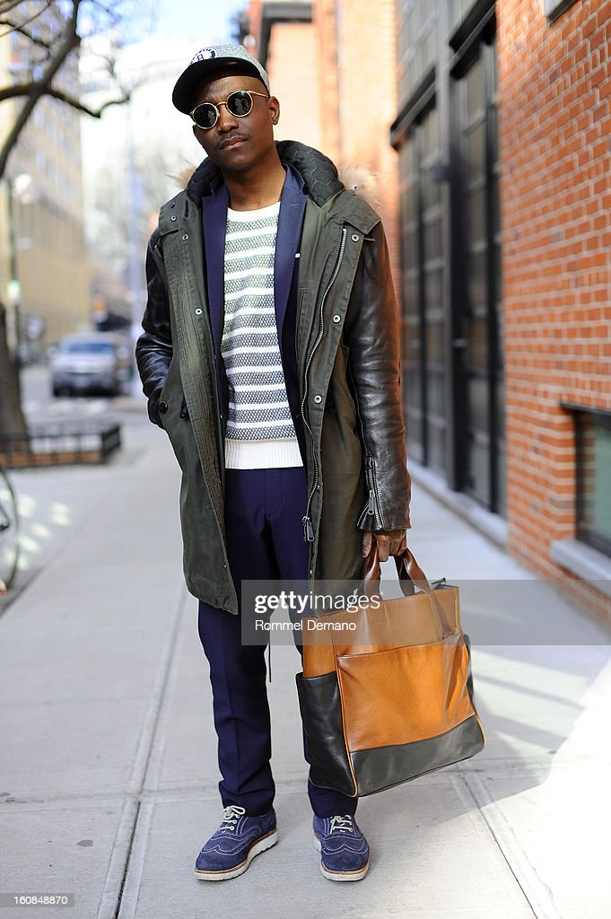 Daper Lou, a fashion photographer, is seen outside the Micah Cohen show wearing RE sunglasses, H&M blazer, Grenson shoes and Coach bag on February 6, 2013 in New York City.