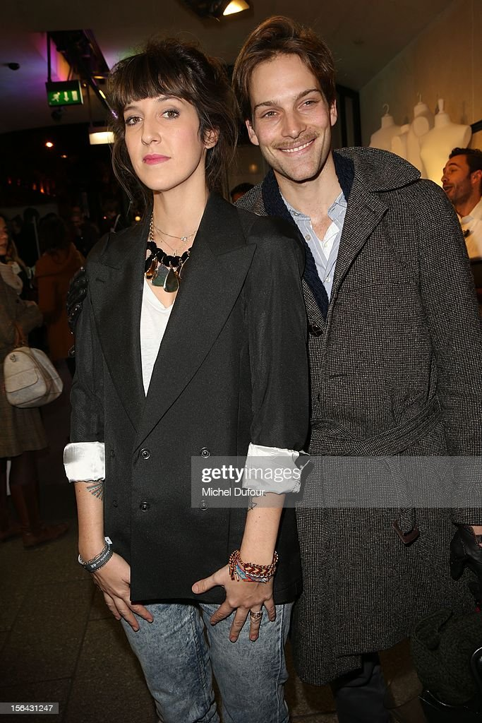 Daphné Bürki and Andy Gilet attend the Maison Martin Margiela With H&M Collection Launch at H&M Champs Elysees on November 14, 2012 in Paris, France.