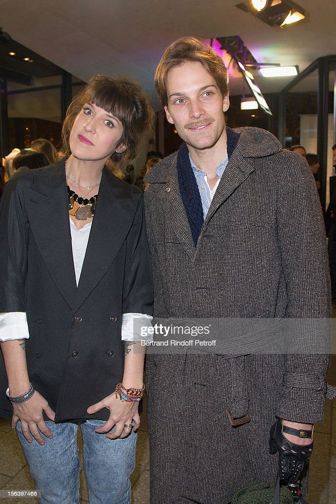 Daphne Burki and Andy Gillet attend the Maison Martin Margiela for H&M collection launch at H&M Champs Elysees on November 14, 2012 in Paris, France.