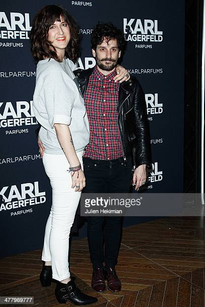 Daphne Burki and Gunther Love attend the Karl Lagerfeld New Perfume launch party at Palais Brongniart on March 11 2014 in Paris France