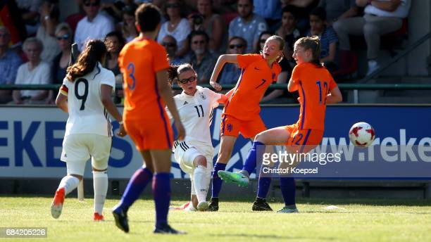 Daphne Buxtorff and Liham Abali of the Netherlands challenge Julia Pollak of Germany during the U15 girl's international friendly match between...