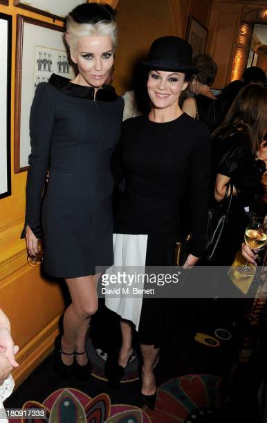 Daphne Guinness and Helen McCrory attend the Harper's Bazaar London Fashion Week SS14 closing party at Annabel's on September 17 2013 in London...