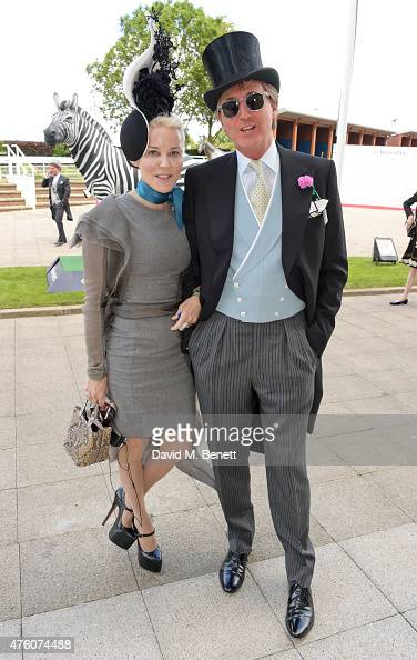 Daphne Guinness and Robin Hurlstone attend Derby Day during the Investec Derby Festival at Epsom Racecourse on June 6 2015 in Epsom England