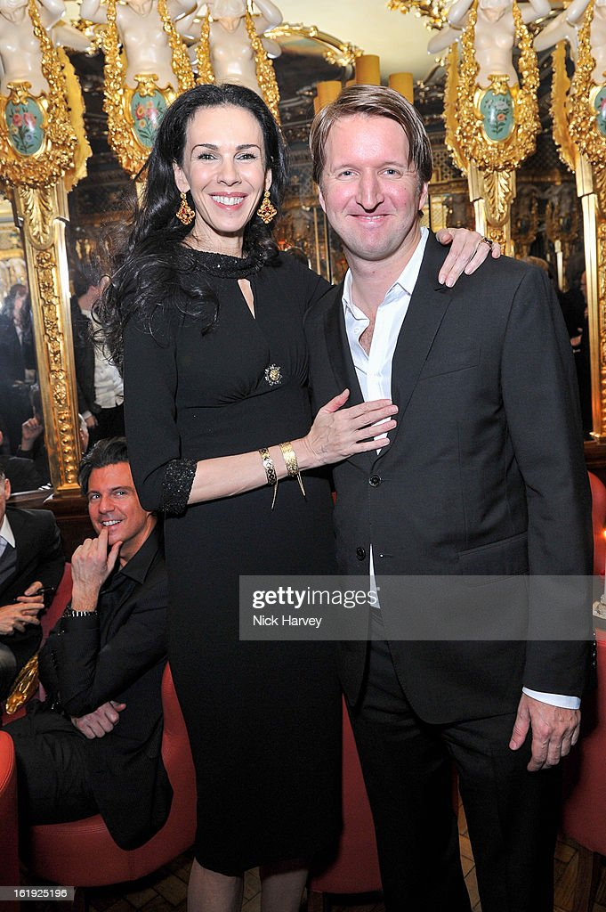 Daphne Guinness and Tom Hooper attends the <a gi-track='captionPersonalityLinkClicked' href=/galleries/search?phrase=L%27Wren+Scott+-+Fashion+Designer&family=editorial&specificpeople=566708 ng-click='$event.stopPropagation()'>L'Wren Scott</a> cocktail party during London Fashion Week Fall/Winter 2013/14 at on February 17, 2013 in London, England.