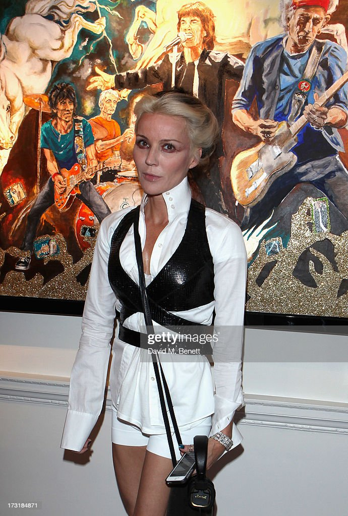 <a gi-track='captionPersonalityLinkClicked' href=/galleries/search?phrase=Daphne+Guinness&family=editorial&specificpeople=213037 ng-click='$event.stopPropagation()'>Daphne Guinness</a> attends the Ronnie Wood Raw Instinct Exhibition Summer Party at Castle Fine Art on July 9, 2013 in London, England.