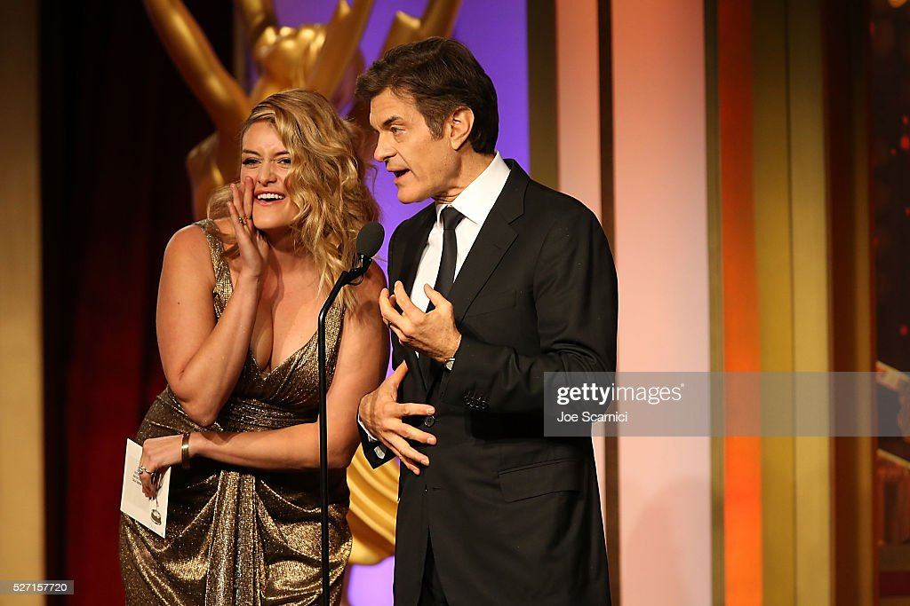 <a gi-track='captionPersonalityLinkClicked' href=/galleries/search?phrase=Daphne+Oz&family=editorial&specificpeople=6264088 ng-click='$event.stopPropagation()'>Daphne Oz</a> and Dr. <a gi-track='captionPersonalityLinkClicked' href=/galleries/search?phrase=Mehmet+Oz&family=editorial&specificpeople=4175862 ng-click='$event.stopPropagation()'>Mehmet Oz</a> announce the Emmy for Outstanding Entertainment Talk Show Host onstage at the 2016 Daytime Emmy Awards at Westin Bonaventure Hotel on May 1, 2016 in Los Angeles, California.