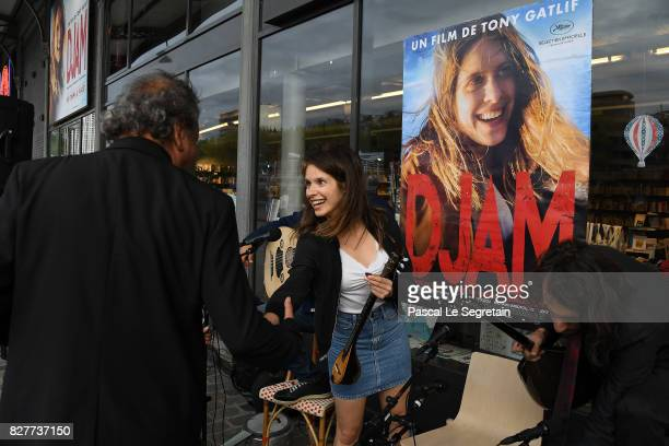 Daphne Patakia and Tony Gatlif attend the Paris Premiere of the film 'Djam' on August 8 2017 in Paris France