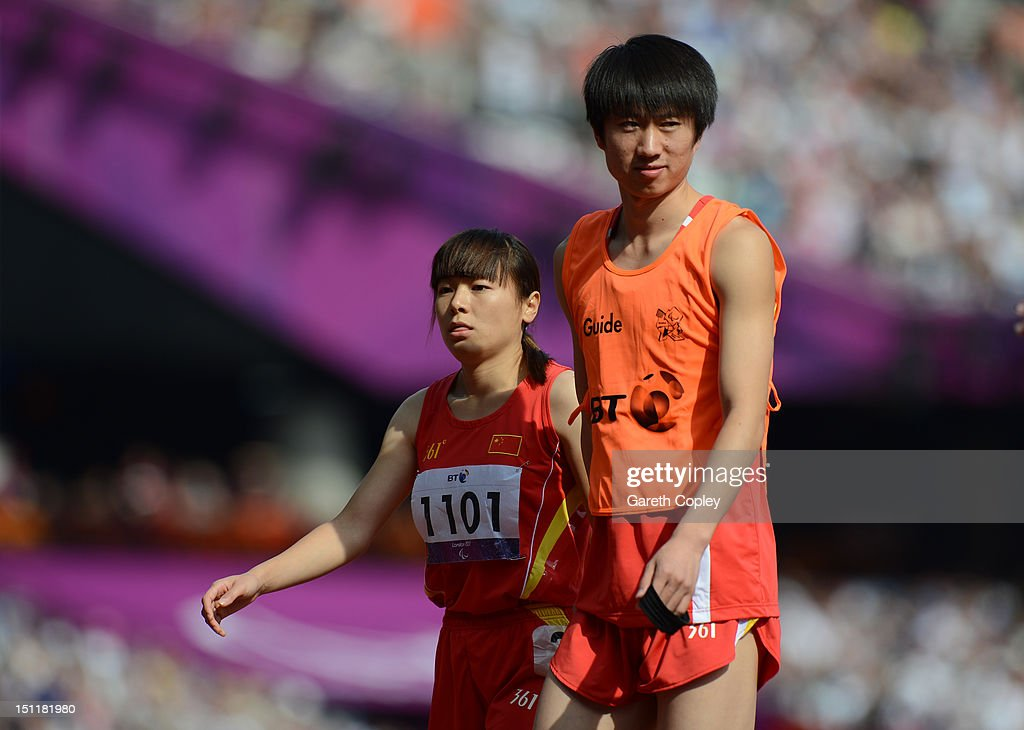 Daqing Zhu of China and her guide Hui Zhang compete in the Women's 400m T-12on day 5 of the London 2012 Paralympic Games at Olympic Stadium on September 3, 2012 in London, England.