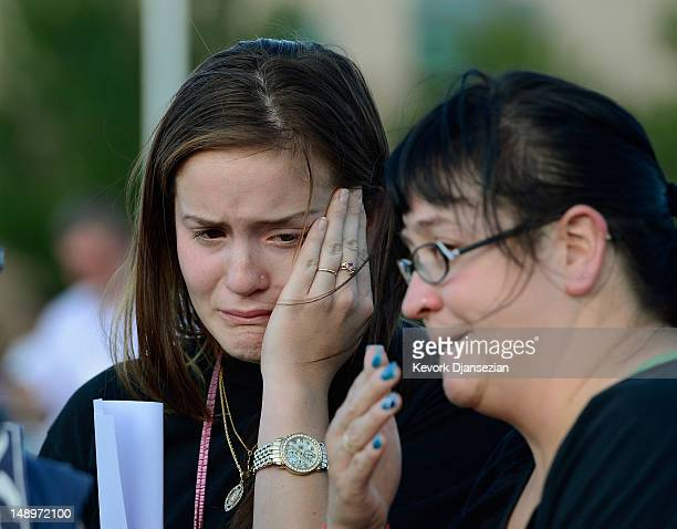Dara Anderson and Monique Anderson cry during a candelight vigil on July 20 2012 in Denver Colorado The vigil took place across the street from the...
