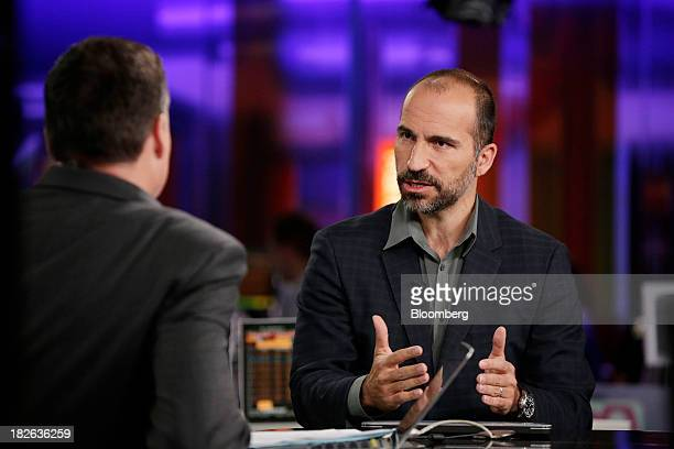 Dara Khosrowshahi chief executive officer of Expedia Inc gestures during a Bloomberg Television interview in London UK on Wednesday Oct 2 2013...