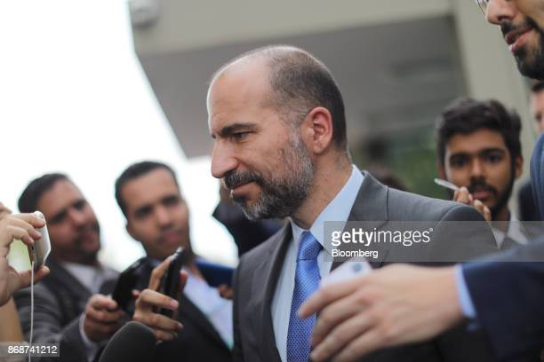 Dara Khosrowshahi chief executive officer of Uber Technologies Inc speaks with members of the media following a meeting with Henrique Meirelles...