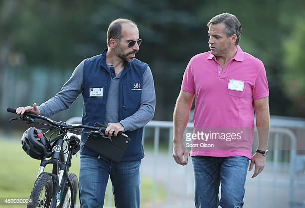 Dara Khosrowshahi president and chief executive officer of Expedia Inc chats with Owen Van Natta chief executive officer of MySpace Inc at the Allen...