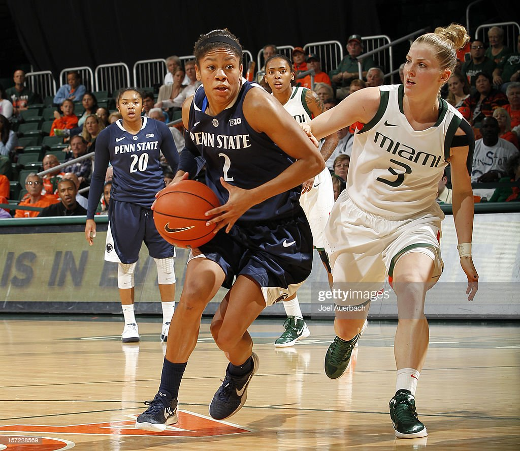 Dara Taylor #2 of the Penn State Lady Lions dribbles to the basket against Stefanie Yderstrom #3 of the Miami Hurricanes on November 29, 2012 at the BankUnited Center in Coral Gables, Florida. Miami defeated Penn State 69-65.