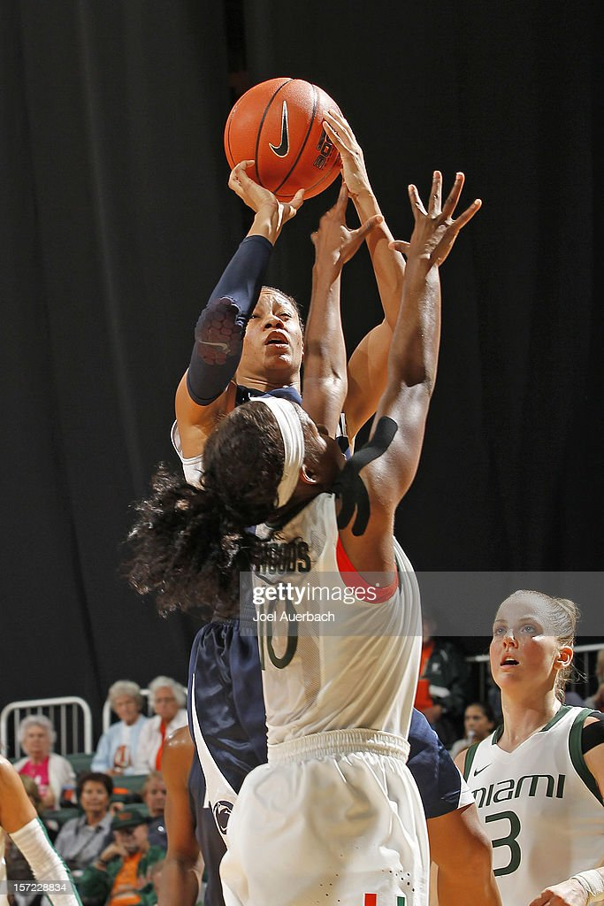 Dara Taylor #2 of the Penn State Lady Lions shoots the ball over Michelle Woods #10 of the Miami Hurricanes on November 29, 2012 at the BankUnited Center in Coral Gables, Florida. Miami defeated Penn State 69-65.