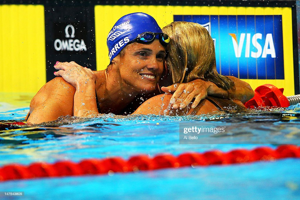 Dara Torres and Jessica Hardy react after they competed in the second semi final heat of the Women's 50 m Freestyle during Day Seven of the 2012 U.S. Olympic Swimming Team Trials at CenturyLink Center on July 1, 2012 in Omaha, Nebraska.